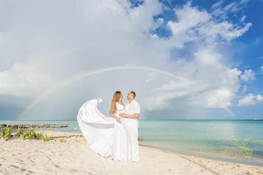 isla mujeres beach photo with rainbow
