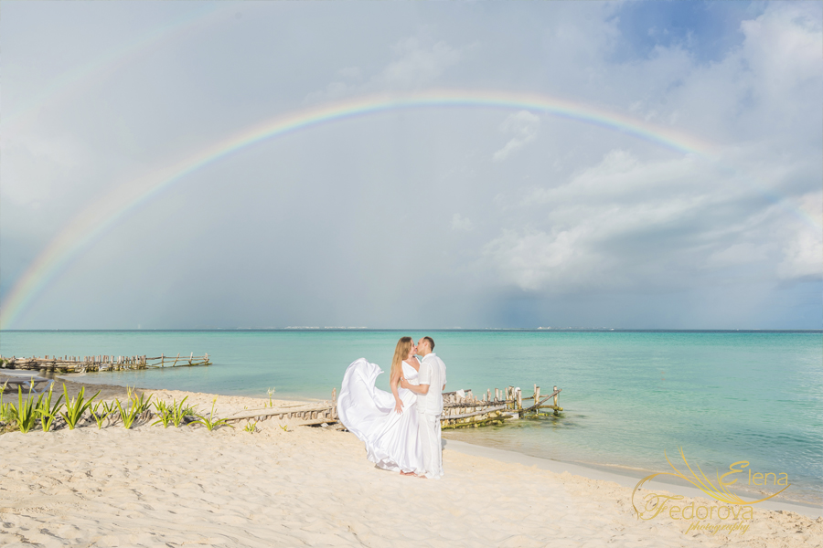 isla mujeres romantic couple photo with rainbow