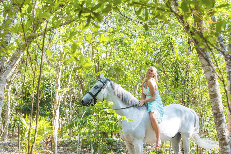 model sitting on horse isla mujeres